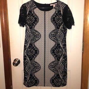 Black and white dress with unique design.